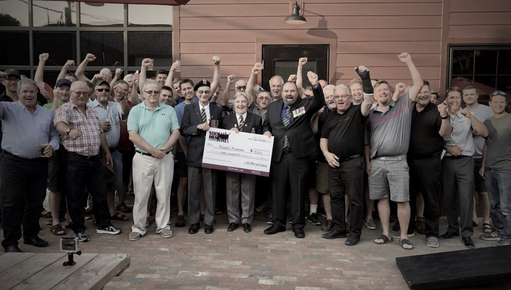 Scugog Historical Society receiving cheque from 100 Men of Scugog