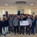 Men presenting cheque to Bereaved Families Of Ontario-Durham Region